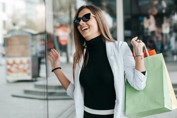 Portrait of young shopaholic woman