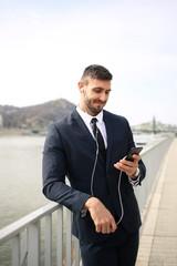 Smiling man checking his phone