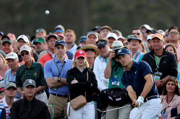Jordan Spieth of the U.S. chips onto the 18th green during first round play at the 2018 Masters golf tournament in Augusta