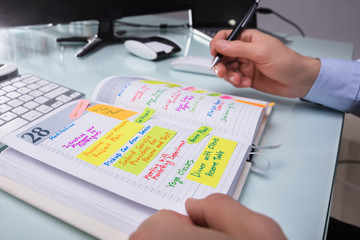 Fototapete - Businessman Writing Schedule In Diary