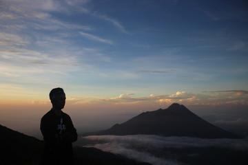 shilouette view of sunrise in merbabu mountain