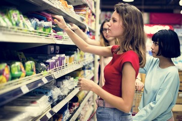Women choosing food from grocery store supermarket
