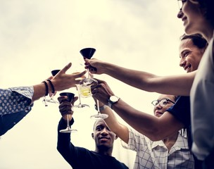 People celebrate together outdoor with beverage