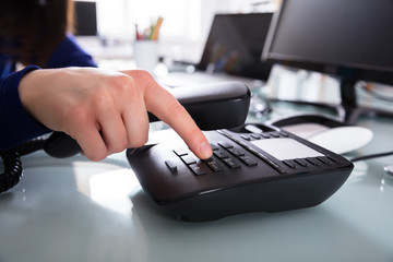 Businessperson Dialing Telephone Number To Make A Phone Call