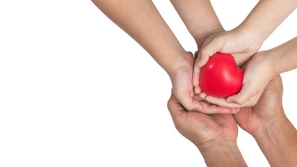 Parents and children's hands (isolated on white background with clipping path) supporting red heart together for life insurance, organ donor donation and health assurance