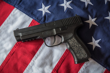Handgun on American Flag