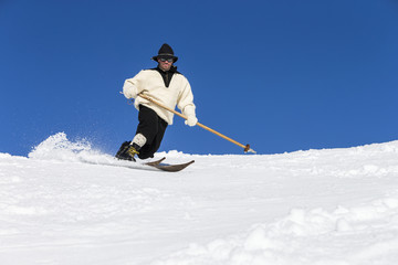 Person skiing in traditional clothing