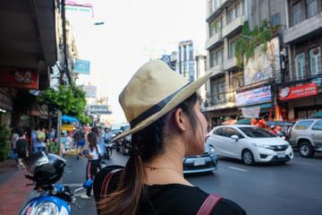 Asian tourist women travel in Yaowarat Chinese road for shopping