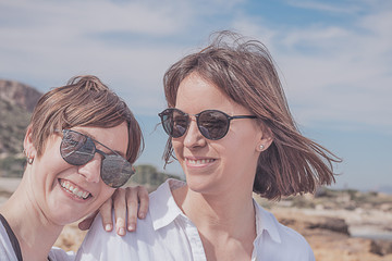 Two friends smiling and happy. Portrait of two young girls