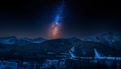 Zakopane in winter at night with milky way, Tatras mountains