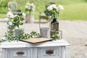 Wooden vintage Dresser, with flower decoration in garden. outdoor. selective focus