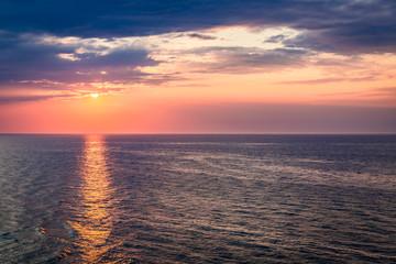 Dynamic dusk over calm ocean in summer, Baltic sea