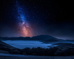 Milky way and foggy valley in Castelluccio, Italy, Umbria