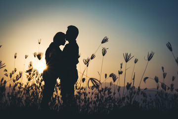 silhouette of Couple in love silhouette during sunset
