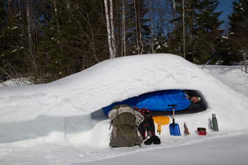 Man is sleeping in a snow cave, cross section