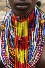 Close-up of a woman from the Arbore tribe with traditional jewelry, Omo valley, Ethiopia.