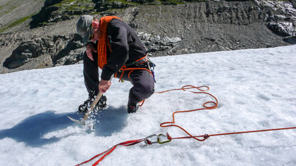male mountain guide during crevasse rescue training on a glacier