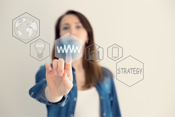 WWW concept with hand pressing a button on blurred abstract background. The abstract image of the hand point to the business virtual hologram. Future technology