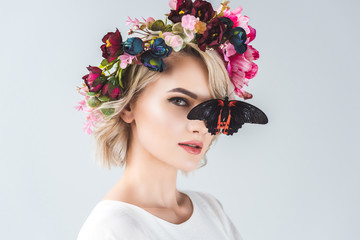Woman with floral wreath and butterfly