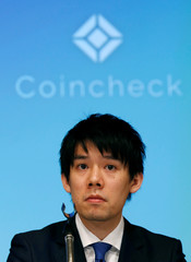 Coincheck CEO Koichiro Wada attends a joint news conference with Monex Group Inc CEO Oki Matsumoto in Tokyo