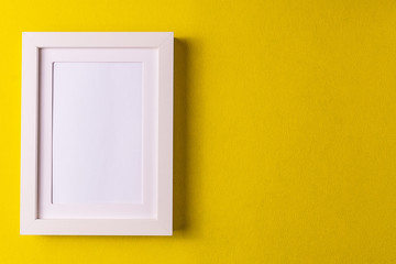 Abstract minimalism colofrul paper background with empty picture frame.;