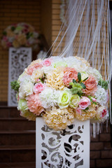 The composition is made by florists from fresh flowers.