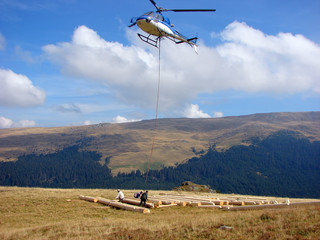 Helicopter is ready transport wood beams