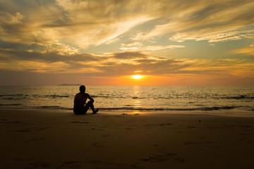 Tourist watching sunset Koh Kradan