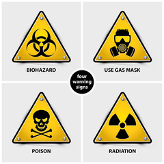 set of warning signs containing four official international hazard symbols, eps10 vector illustration