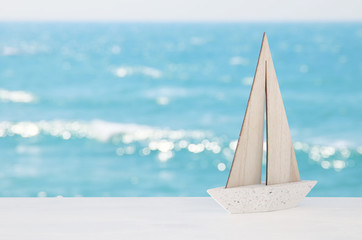 nautical concept with white boat over tropical sea landscape background.