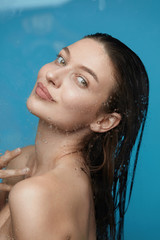Woman In Shower. Beautiful Female With Wet Hair
