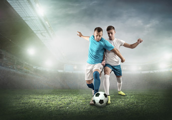 Soccer player on a football field in dynamic action at summer