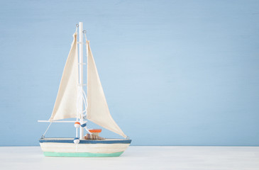 nautical concept with sail boat over blue background.