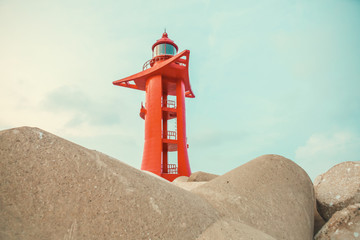 Red color lighthouse at Jeju Island - South Korea