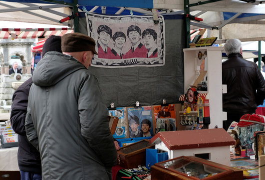 Customers browse through second-hand CD's and vinyl records on a market stall in Loughborough