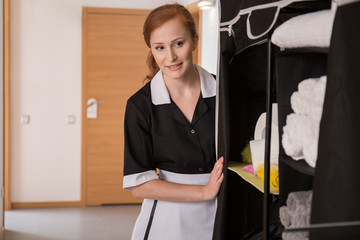 Maid in uniform in corridor