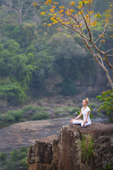 Serenity and yoga practice with woman at the cliff