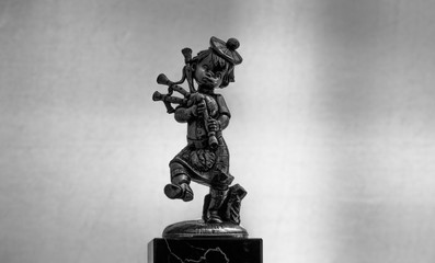 Metal Statue Of A Bagpipe Player