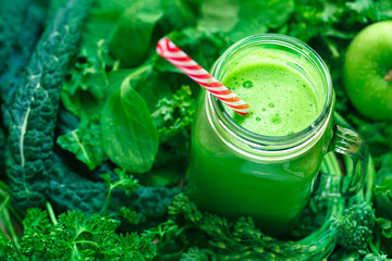 Fresh Leafy Greens Juice in a Glass Jar with a Red Striped Drinking Straw