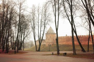 Veliky Novgorod, Russia, autumn foggy scene Novgorod Kremlin tower and autumn foggy park