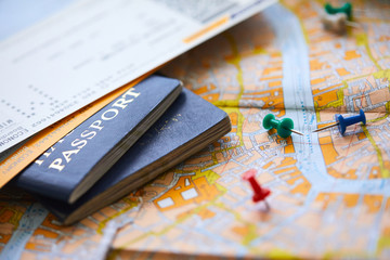 pins marking travel itinerary points on map and passport Fotobehang