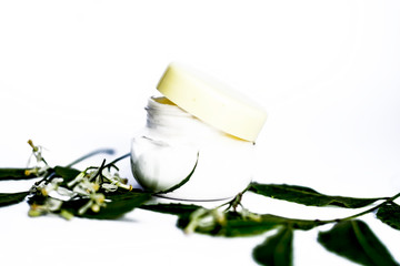 Close up of cream of Neem,Nim, Indian Iilac or Azadirachta indica with the leaves of neem tree isolated on white with benefits like it removes the black skin and acnes and pimples.