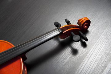 violin on black table