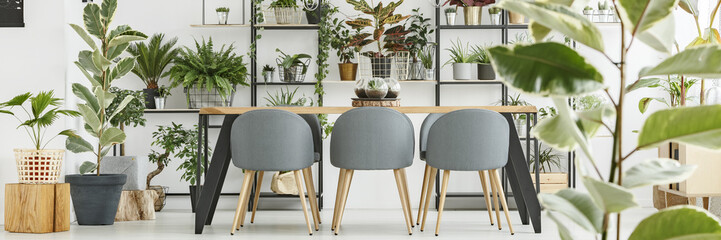 Wooden table and grey chairs