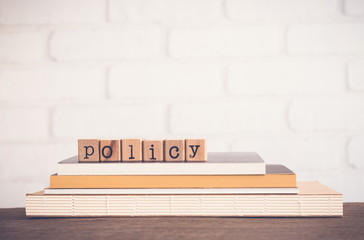 The word Policy and blank space background.