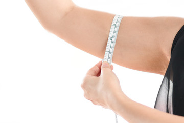 Woman measuring her arm fat on white background.