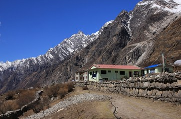 Hotel in Mundu. View down the Langtang valley, Nepal. Sunny spring day in the Himalayas.