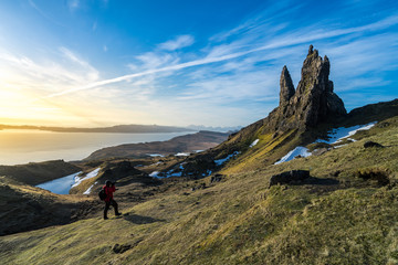 A man take a photo of The Old man of Storr in morning time with clear sky in winter