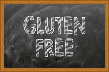 GLUTEN FREE written in chalkboard. Conceptual image with word GLUTEN FREE. Photo stock.