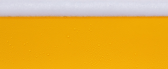 Self adhesive Wall Murals Beer / Cider Drops of water on a glass of beer. Background, Texture, banner size